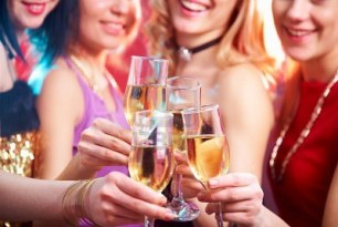 11334194-beautiful-girls-clink-glasses-of-champagne-at-a-party